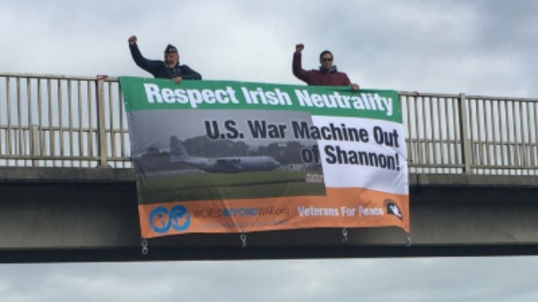 Will Griffin and Tarak Kauff drop Banner that says Respect Irish Neutrality