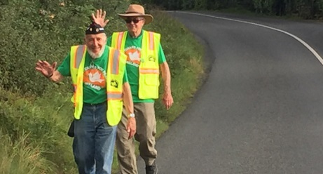 Ken and Ed marching on a road in Ireland